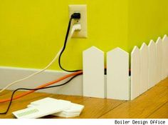 Gotta confess, though it might be considered a little 'cute' this solution definitely lends itself to neatening up the look of your room by hiding all the electrical cords we find necessary to life these days...