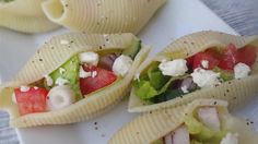 Stuffing jumbo pasta shells makes a cute way to dress up a simple salad of romaine, salami, cucumber, and tomato.