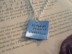 """Labyrinth  Quote Stamped Pendant """"Through Dangers Untold"""". $18.00, via Etsy."""