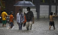 Children play on a flooded street during monsoon rains in Mumbai. ■ Photo: AP