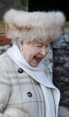 Just love this shot of the Queen in this fuzzball of a hat with a surprised laugh on her face! Cute!