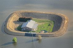 A levee protects a house from Yazoo River floodwater near Vicksburg, Miss., on May 18, 2011. The flood engulfed many towns and farms upstream.
