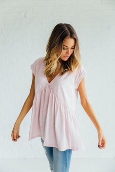 DETAILS:   Deep V-Neck Ruffled Short Sleeve Top 100% Cotton Model is wearing a small