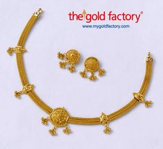 Three woven heley chains bunched together with fancy 'eye' clips, a wire and ball flower in the centre, and clumps of ball thokas all round ----- that's this dainty little party necklace.   All in 22K hallmarked gold, with matching eartops.  Necklace- 15 gm and price Rs. 47,400/- Earrings - 4 gm and price Rs.12,600/-