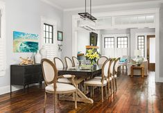 A home gains needed space with an expanded second story that preserves the house's footprint and its neighborly facade Dining Room Images, Dining Room Design, Dining Room Light Fixtures, Dining Room Lighting, Kitchen Seating Area, Room Design Images, Traditional Dining Rooms, Beautiful Dining Rooms, Room Pictures