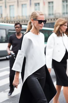 Holli Rogers wearing an asymmetric white top & leather skinnies