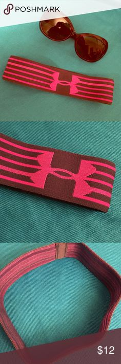 Under Armour Girls' Headband Authentic Under Armour Girls' Headband. Non-Slip Headband Built for Athletes. Grey with Bright Pink Stripes and UA Logo. Grey Strip on the Back. 64% Polyester/28% Nylon/8% Spandex. Brand New with Original Packaging. Excellent Condition. No Trades. Under Armour Accessories Hair Accessories
