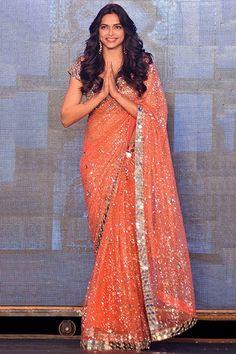 Actress Deepika Padukone's sparkling sari could put the Milky Way to shame.