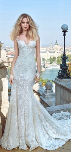 Wedding Dress by Galia Lahav. With Gwen romance is created in this shimmering medieval dress through layers of various laces and embroidered net. The gown demonstrates movement and exhibits a deep opened back, with fabric gatherings to accentuate the rear.