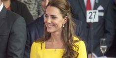 Close up of square neckline of Kate's yellow dress