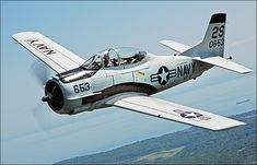 North American T-28 Trojan.When USAF set out to replace aging T-6 Texan trainers,North American hired to complete task.Trojan,had frameless canopy & Wright R-1300 engine when combined, gave speed over 280mph.1st order of 266 in 1950 grew to 1,194.Evident that USAF found successful design,USN & USMC adopted.2 years later, 489 standardized T-28Bs ordered by Navy,differing from T-28A in use of more-powerful Wright R-1820-86.After 299 Cs produced, fitted with arrester gear for carrier training.