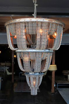This chandelier is made from bicycle chains, wheels and other parts and it is a part of a series called Connect created by artist Carolina Fontoura Alzaga.