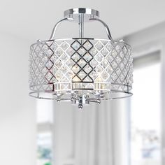 Dazzling crystals catch the light and create a richly elegant ambiance in any room. This flush-mount chandelier encases five 60-watt bulbs, finished with a chrome lattice shade and a chrome base.