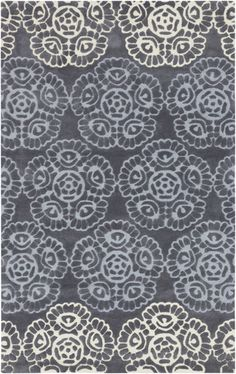 Beautiful medallions on this Mamba rug look like lace doilies, and are very chic in shades of gray. By Surya. (MBA-9019)