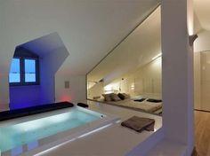 Attic bathtub, modern lighting. WOW.