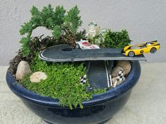 Miniature Fairy Garden - SPEED RACER. Go Speed Racer, Go! SPEED RACER turning the corner to the finish line while Racer X is not far behind. 4/2016