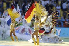 2014 FIFA World Cup closing ceremonies Dancers perform during in front of a German flag before the start of the World Cup final soccer match between Germany and Argentina at the Maracana Stadium in Rio de Janeiro, Brazil, Sunday, July 13, 2014. (AP Photo/Victor R. Caivano)