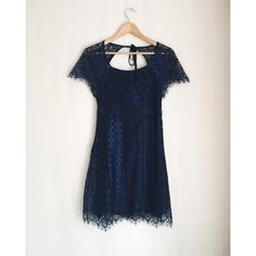 For Love and Lemons mini lyla dress For Love and Lemons mini lyla dress  NEW - tags taken off but NEVER WORN!! black/navy blue lace, size MEDIUM  Classic For Love and Lemons mini lace dress with backless detail that ties together! Very feminine super cute, great for a night out or classy dinner!   NO TRADES For Love and Lemons Dresses