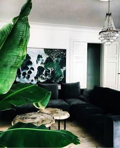 Summer style!! GREEN AND WHITE!! Great dark green velvet sectional with a green and white artwork in a modern living room!