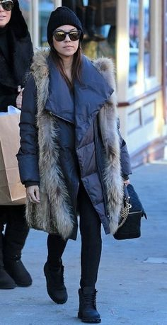 Kourtney Kardashian wearing Timberland Boots in Black, Westward Leaning N 10.3 Wintermute Sunglasses, Chanel Globe Trotter Vanity Bag and Barneys New York Oversized Beanie.