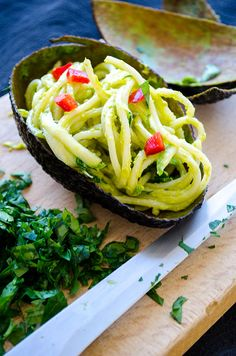Making this guilt-free vegan creamy avocado pasta is very easy. It has no cream but so creamy and yummy! Garnish with thinly grated zucchini and red pepper.   giverecipe.com   #pasta #avocadorecipes #avocadopasta #healthyrecipes #healthypasta #avocadospaghetti #vegan #vegetarian