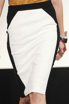 when trying on a ponte pencil skirt, the fit should be snug. ( even a little snugger than this example) Extra fabric looks sloppy and adds weight. when the skirt is fitted and paired with a suit coat, sweater or loose tucked-in blouse it looks fantastic and creates curves for the woman with a straighter figure.