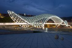 The Bridge of Peace is a bow-shaped pedestrian bridge over the Kura River in Tbilisi, capital of Georgia by architect Michele De Lucchi.