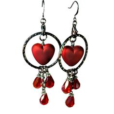 A bit of Steampunk for Valentines day or any day! In edgy dark gunmetal. Original crimson heart dangle earrings with hammered metal loops. Featuring