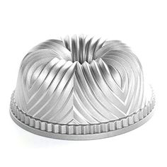 Made of heavy cast aluminum for excellent heat conductivity, this ornately fluted pan is ideal for baking festive cakes. The pan's heat-reflective exterior ensures the cakes will be uniformly browned. It's also perfect for molding salads and chilled desserts. The interior is coated... - http://kitchen-dining.bestselleroutlet.net/product-review-for-nordic-ware-pro-cast-bavaria-bundt-pan/