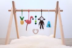 Tropical Island adventures baby gym. Flamingo, Pineapple, Monkey, Mountain. Activity center, gender neutral, wooden frame, baby gym toys by LanaCrocheting on Etsy https://www.etsy.com/listing/533521719/tropical-island-adventures-baby-gym