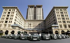 Year opened: 1928 (tower 1994). The Rolls-Royces (in signature Peninsula Green) on the forecourt and the page boys (in white) on the door set the tone. This is carefully nurtured old-school luxury overlaid with a lively air of metropolitan glamour. It's best exemplified by the giant traditional Fu dog in the lobby, sculpted – in keeping with the hotel's desire to embrace old and new – by American Pop artist Jim Dine. Jim Dine, Fu Dog, Door Sets, Page Boy, Old And New, Old School, Hong Kong, Multi Story Building, Rolls