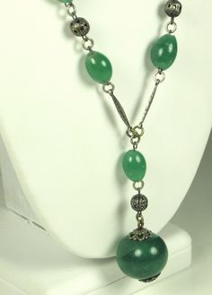 30% off Sale until 11/21/15 A silver and green glass necklace. The #necklace chain is made up of oval shaped green glass beads that are attached to flattened silver diamond shaped sections as well as a... #vintage #diamonds #gold #rings #dangle #balls #filigree #present #woj #judysgems2 #classic #teamlove #christmas