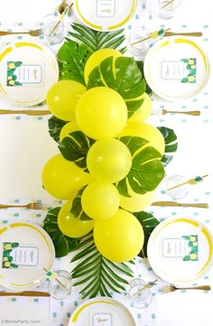 DIY Balloon & Fronds Tropical Party Centerpiece - learn to craft this stunning but easy to make garland for your party table, photo booth or birthday decor!