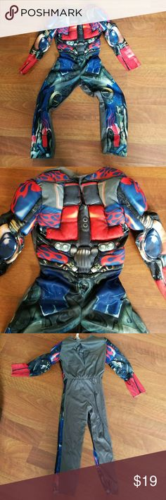 TRANSFORMER Costume Size Medium 7/8 Great costume for boys and girls. Fits a Size 7/8  or Medium. Has a puffy chest to look like you got muscles. Velcro closures in the back.  So cute! Costumes Superhero