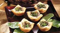 Mushroom-Garlic Cream Tartlets - I made these about 2 weeks ago for a party and they were a huge hit!  I used baby bella mushrooms - better flavor!
