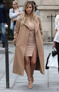 Kim Kardashian looking stunning in a classic camel maxi coat