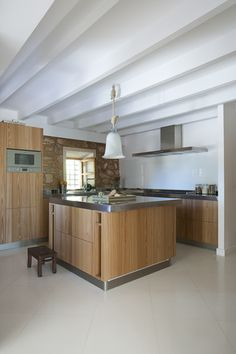 Kitchen - A contemporary kitchen with stainless steel counters and island