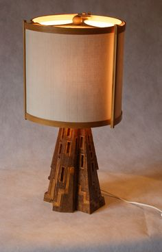 Carved wood lamp with hand made shade.