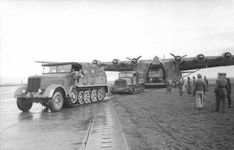 Unloading a Me 323 Gigant transport aircraft. Tunisia, December 1942