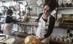 Staff behind the counter at L Manze eel, pie and mash shop in Walthamstow. Photograph: Sean Smith for the Guardian