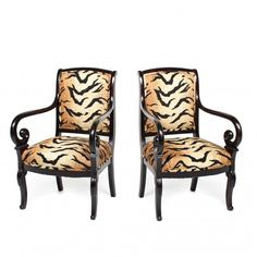 This pair of antique scroll armchairs have been updated with glamorous animal print fabric.