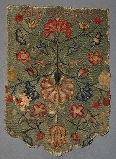 Winterthur 1958.2325 cross stitch Pocketbook, marked John Almy 1747. Wool, linen. 10.25 x 7 inches