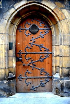 a cathedral door in Prague...but also looks like a CASTLE door!!! Love this style!