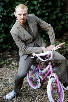 I could have SWORN I pinned this before but I couldn't find it. Nevertheless, it's Simon Pegg on a girls bike... so it's worth pinning again