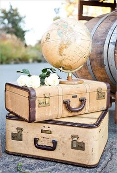 suitcases and globe decor / http://www.deerpearlflowers.com/travel-themed-wedding-ideas-youll-want-to-steal/2/