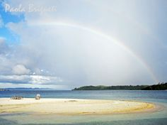 Rainbow in the Togian Islands Indonesia--saw a white rainbow in Maui once and white aurora borealis in No. Idaho--very ethereal!