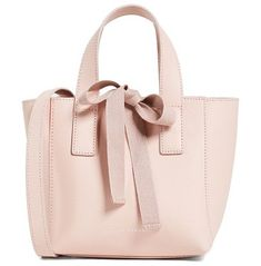 mini ribbon shopper tote by Loeffler Randall. Leather: Cowhide Striped ribbons Snap at top Tie at top Patch interior pockets Zip interior pockets Adjustable straps Dust bag included Weight: 14oz / 0.4kg Imported, China Measurements Height: 6.75in / 17cm Length: 6.75in / 17cm Depth: ... #loefflerrandall #bags