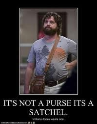 its not a purse, its a satchel. Indiana Jones wears one:) lol love the Hangover!