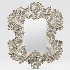 The Stella mirror reminds us of sea inspired prose by great men like Tennyson or Longfellow. This French inspired piece replaces silver gild with silver abalone shell elegantly arranged upon its curve