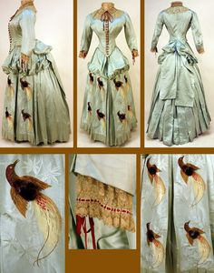 """Bustle dress, 1880s. Pale aqua silk faille. The skirt's three front panels are brocaded with tropical foliage and birds in gold, burgundy, plum, red, and brown, with a body of tufted silk floss in high relief. The pointed, boned bodice has an embroidered net collar and cuffs laced with red ribbon. The bodice has crocheted buttons and is lined in cotton twill.The waist measurement is 23"""", which is not as bad as it looks."""